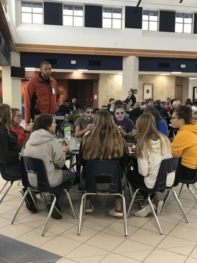 Deputy Matt Eberhardt, the new school resource officer at Chilton Public Schools, often speaks with students during lunch in the commons.