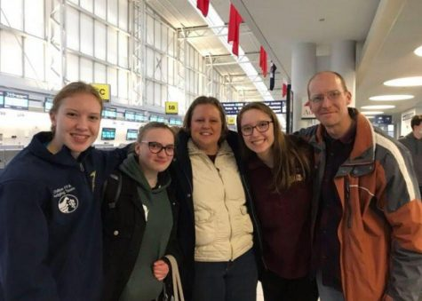 Silvia Usai (second from right) says farewell to her host family the Diedrichs, including junior Julia Diedrich (far left), at the airport in Chicago.