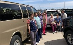 The Chilton School District nutrition services staff of Jill Frank, Joan Walber, Ann Wilcox, Mary Kolbe, Noreen Gruel, Cindy Neuber, Lisa Scharinger and Lynn Pendleton (not pictured, Ann Paulson) stand by the school vans they use to deliver hundreds of meals to several sites throughout the district each school day during the school closure.