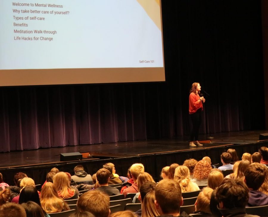 Rise Together's Vice President of Operations Ms. Nadine Machkovech speaks with the CHS student body in the Engler Center for the Performing Arts as part of the Mental Health Wellness Festival held in March.