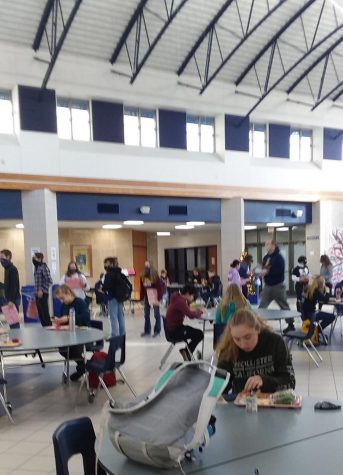 Photo by Claudia Brown While lunch provides students a short break from wearing their masks as they eat and drink, social distancing still dictates how they stand in line and where they can sit.