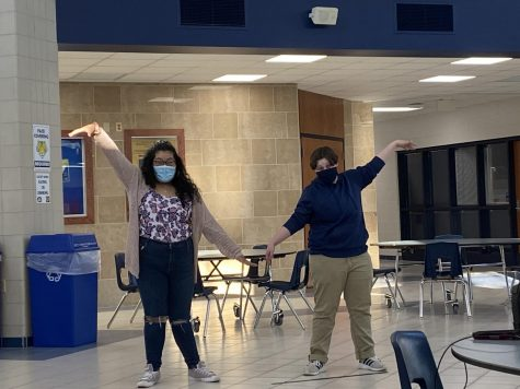 Photo by Alex Bowe  Freshman Esther Garcia and sophomore Auggie Knaus choreograph the song
