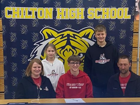 Photo submitted by Mr. Corey Behnke  Senior Alek Lemke (center) is joined by his family as he signs a letter of intent to play baseball for the Grand View University Vikings. Grand View University is a small private liberal arts university in Des Moines, Iowa.