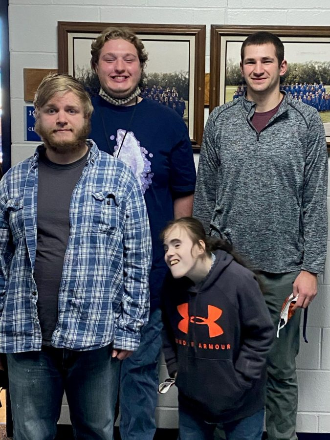 Photo by Alex Bowe  Seniors (front) Cody Fritz, Madison Maney and (back) Spencer Kratz plus Mr. Danny Mallmann, a special education teacher, give students birthday notes that they can turn in for treats.
